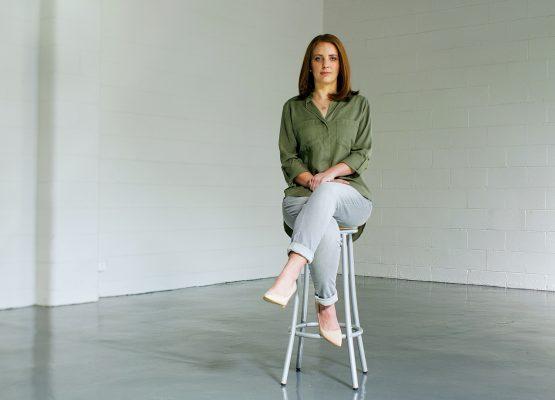 Emma sitting on a chair